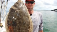 Kevin Kirsh catches a Flounder while saltwater fishing in Virginia Beach near the Chesapeake Bay Bridge Tunnel