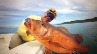 Mark Davis catches a giant cubera snapper on a topwater lure while saltwater fishing out of Crocodile Bay Resort in Costa Rica