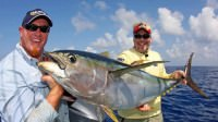 Mark Davis and Kevin Beach catch a giant yellowfin tuna off the coast of Venice, Lousiana